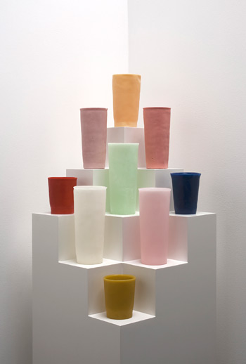 George Stoll, Untitled (9 tumblers on a stepped corner pyramid) #2,  2011, beeswax, paraffin, paint and plywood, 12 x 64-3⁄4 x 12 inche